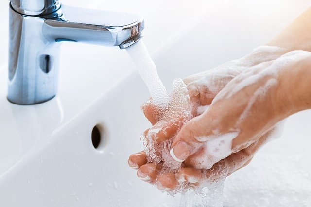 None of the studies revealed a link between mask-wearing and a reduction in hand hygiene. (Shutterstock)