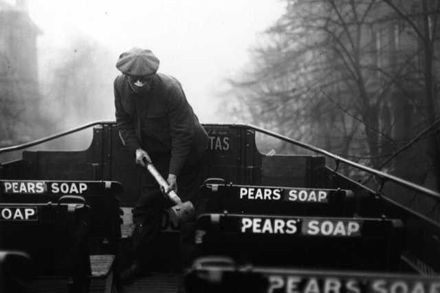 A man spraying the top of a bus with an anti-flu virus during the Spanish flu epidemic (Photo: Davis/Getty Images)