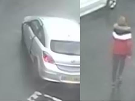 Police are looking to identify the driver of the car, believed to bea Vauxhall Astra, as well as the woman in the red jacket. (Credit: Lancashire Police)