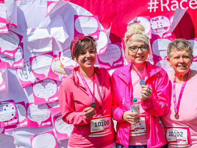 Race for Life participants with their medals