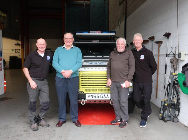 Tony Harrison with Bowland and Pennine Mountain Rescue Team  members Ian Maddison (far left) and Paul Durham (far right)   and Norwest Fellwalking Club secretary David Johnstone.