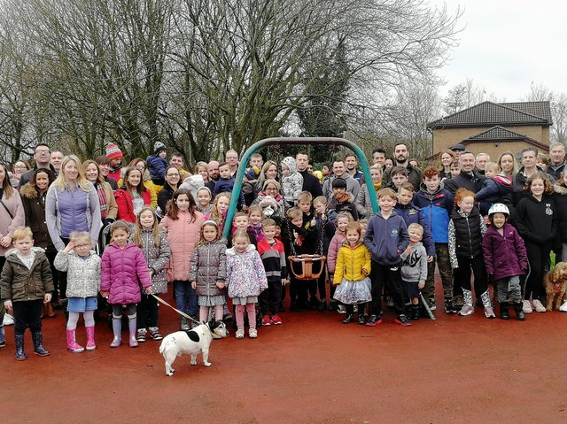 The fun stops here - families gather around Walton Park playground's last piece of equipment