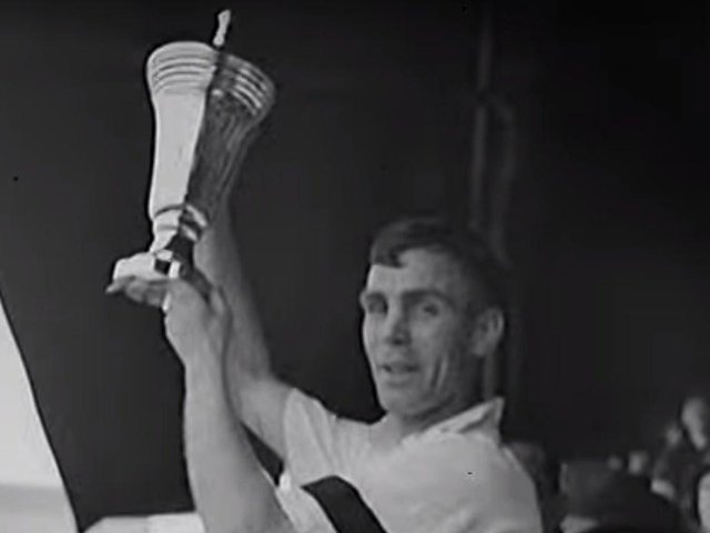 Tom Smith lifting the war cup for Preston North End in 1941