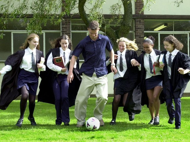Pupils from Southlands High School, Chorley, who competed in the Magistrates Mock Trial Competition try out their football skills with Bolton Wanderers player Gudni Bergsson who is also a qualified lawyer