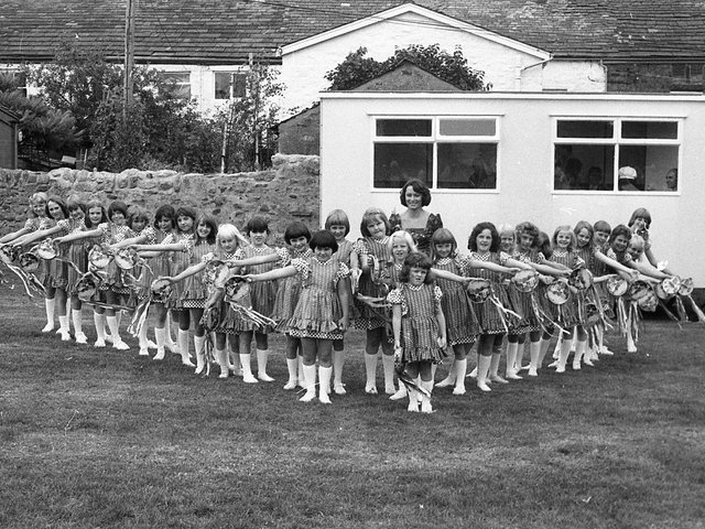 The village of Ribchester gave itself over to fun and frolics when the annual Field Day was held there. The Ribchester morris dancers, a team of 26 local girls, went through their paces on the village field, and are pictured above