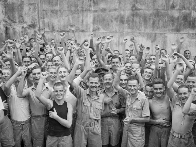 Allied prisoners of war celebrating their liberation from Changi Jail, Singapore, in 1945