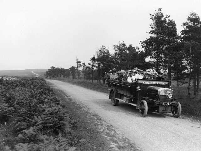 1913:  An early open topped charabanc taking passengers on a trip over the moors, near Whitby, North Yorkshire.  (Photo by Hulton Archive/Getty Images)
