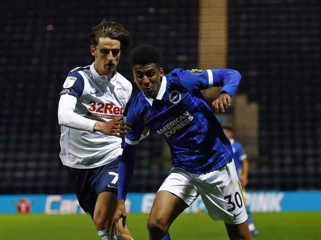 Preston midfielder Tom Bayliss tussles with Brighton's Bernardo