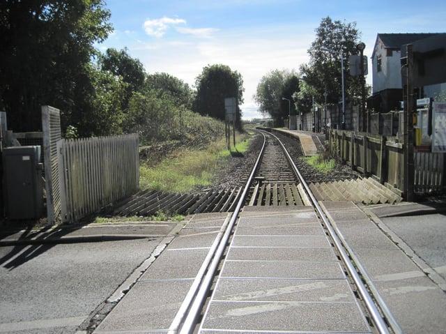 Moss Side rail station level crossing