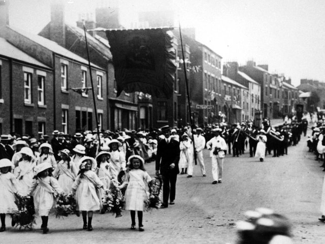 Kirkham and Wesham Club day procession - early 1900s - along Poulton Street, Kirkham, led by little flower girls, with brass band in background