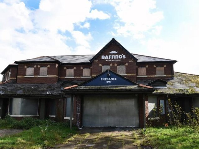Shuttered up and overgrown, the ravages of a year since Baffito's closed.