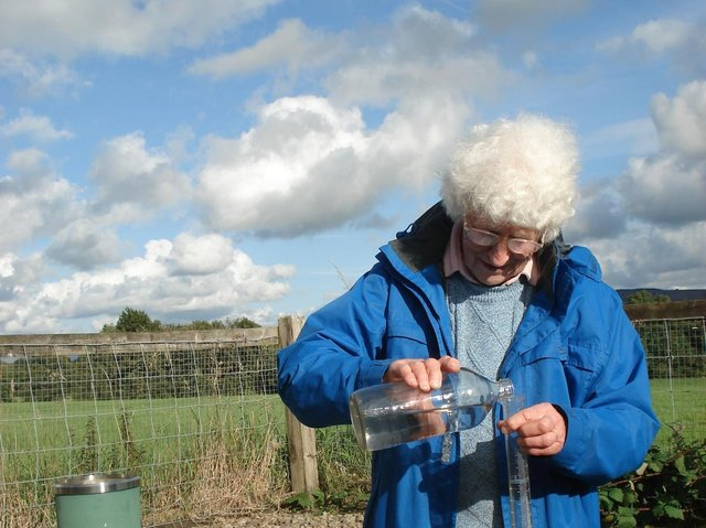 Muriel Lord pictured checking daily rainfall levels