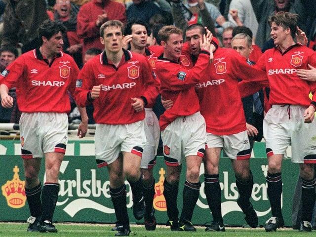 United celebrate Eric Cantona's late FA Cup final winner in 1996