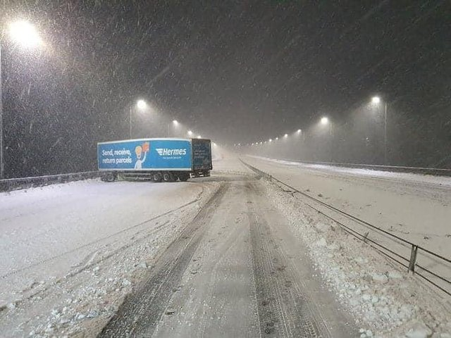 Lorry jacknifed in the snow on the M62 near Rochdale. Pic: West Yorkshire Police