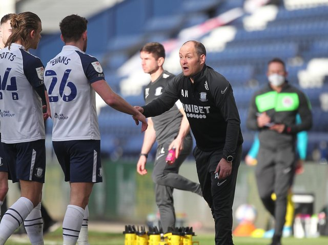 Preston North End manager Alex Neil dishes out instructions to Brad Potts and Ched Evans during the win against Huddersfield