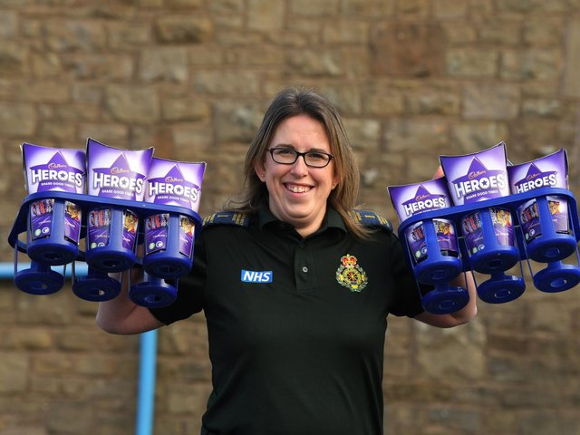 Paramedic and parent Jeanette Fitton with the chocolates collected by Longridge pupils. Photo: Neil Cross