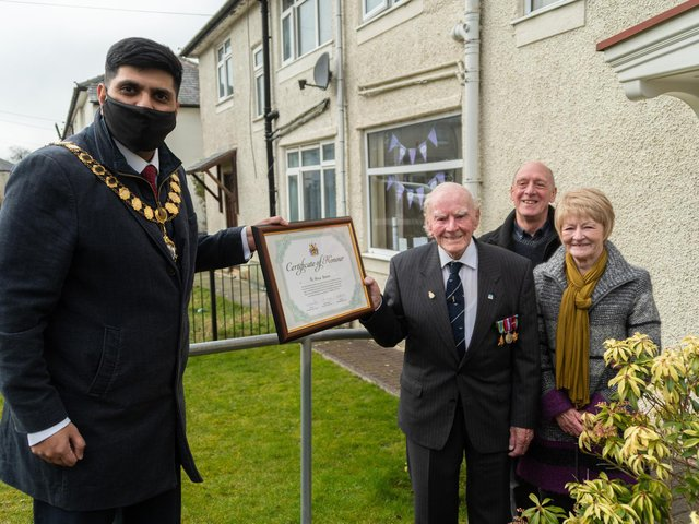 Burnley Mayor Coun. Wajid Khan presenting the Certificate of Honour to Mr Stephen Bacon, watched by his proud daughter and son-in-law