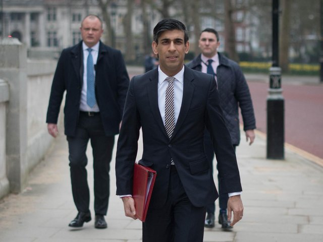 Chancellor of the Exchequer, Rishi Sunak, walks from the Treasury to No 11 Downing Street, London, the day before delivering his budget.