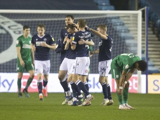 Millwall congratulate Scott Malone after he equalised.