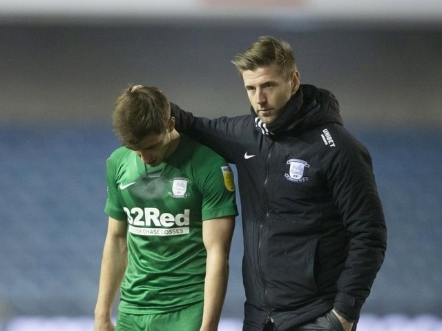 Preston North End midfielder Jayson Molumby is consoled by Paul Gallagher after the defeat at Millwall