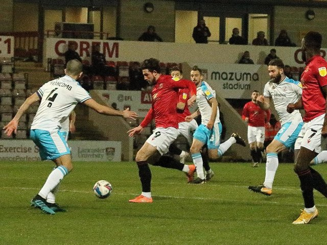 Cole Stockton opens the scoring for Morecambe in their midweek win against Crawley Town