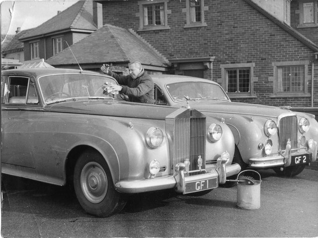 George Formby with his personalised Rolls Royce cars at his home