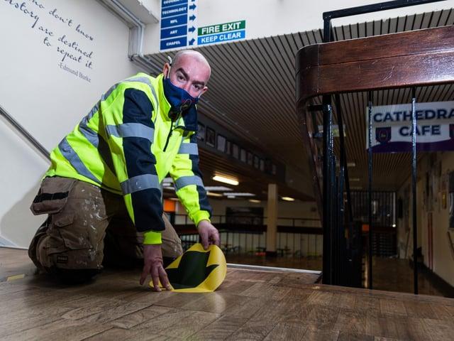 Floor stickers are laid at Archbishop Temple School, Preston. Photo: Kelvin Stuttard