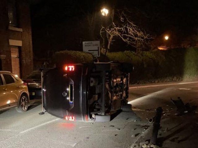The car on its side in Town Road, Croston (Image: Lancs Road Police).