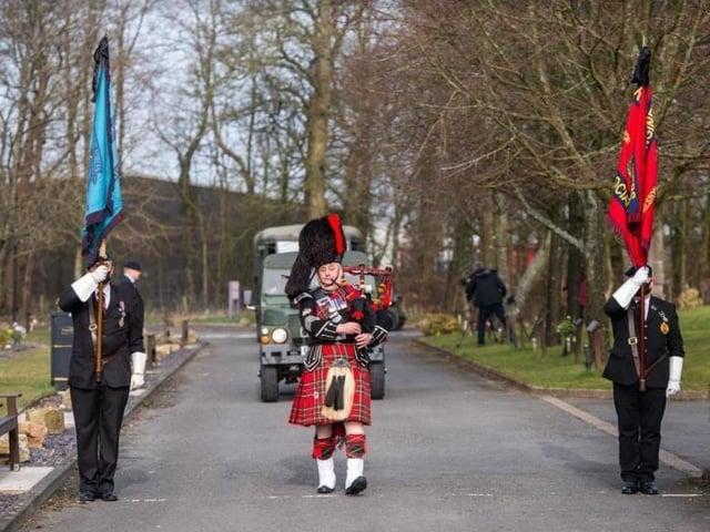 A piper greets the cortege to Preston Crematorium.