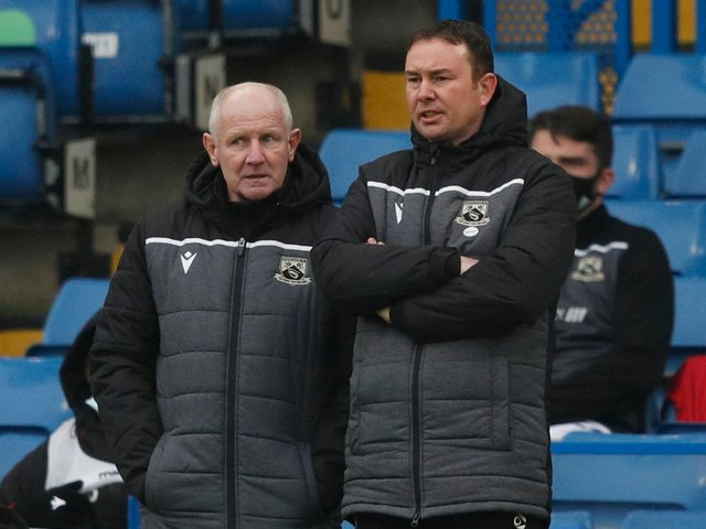 Morecambe's management team celebrated another three points on Saturday
