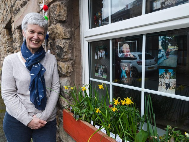 Fiona Elcomb pictured in front of the window display she has created in memory of her friend Janis Whitlock
