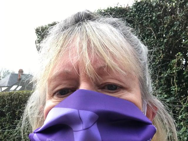 Janet Newsham, Greater Manchester Hazard Centre, wearing her International Workers' Memorial Day mask.