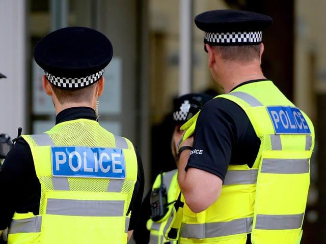 Two people were injured during a violent disturbance in Darwen.