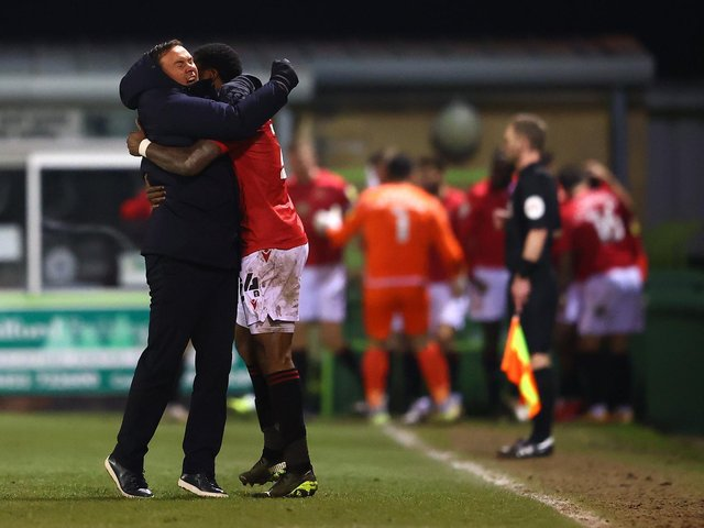 Derek Adams and Yann Songo'o celebrate Morecambe's late equaliser at Forest Green Rovers