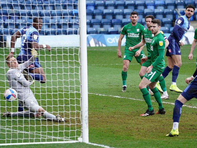 Preston North End goalkeeper Daniel Iversen is beaten by Ryan Tafazolli's header for Wycombe's winner
