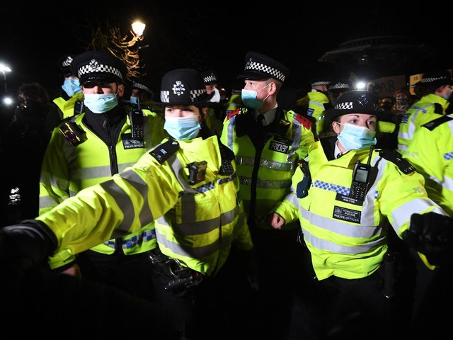 Police officers clash with people as they form a gathering in Clapham Common, London, after the Reclaim These Streets vigil for Sarah Everard was officially cancelled