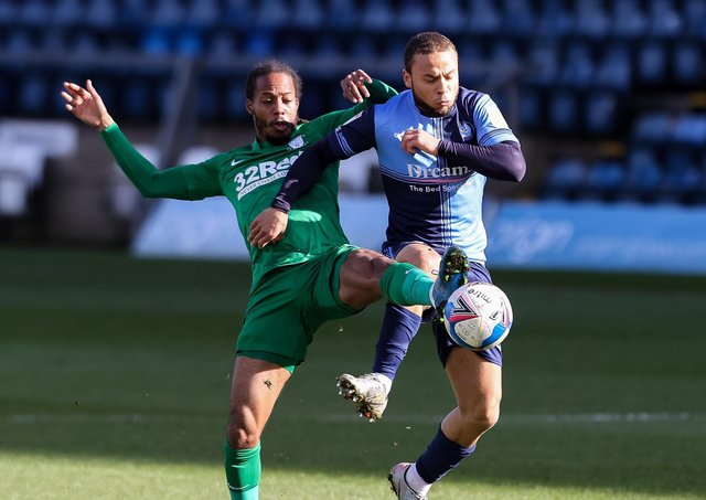 North End's Daniel Johnson battles with Wycombe's Curtis Thompson at Adams Park