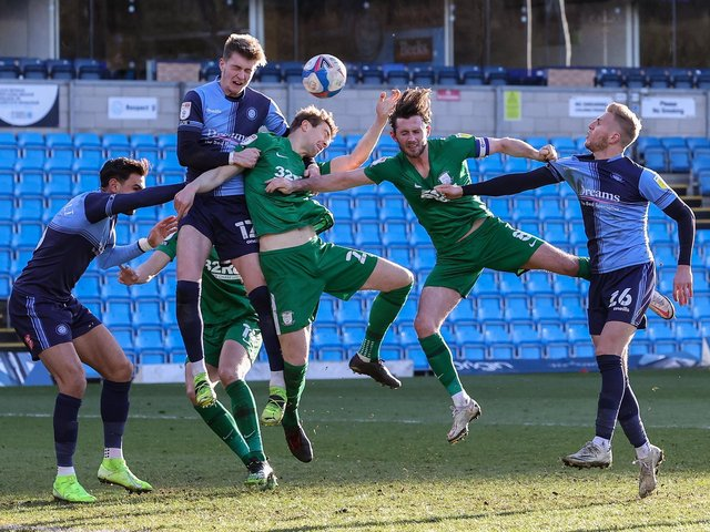 Paul Huntington challenges for the ball against Wycombe.