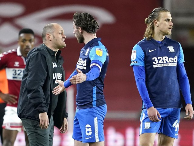 Alan Browne and Alex Neil protest the PNE skipper's red card.