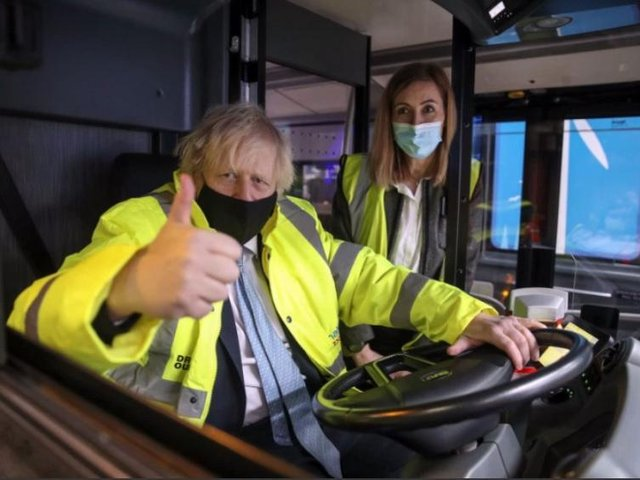 Boris Johnson at the wheel of a new electric bus.