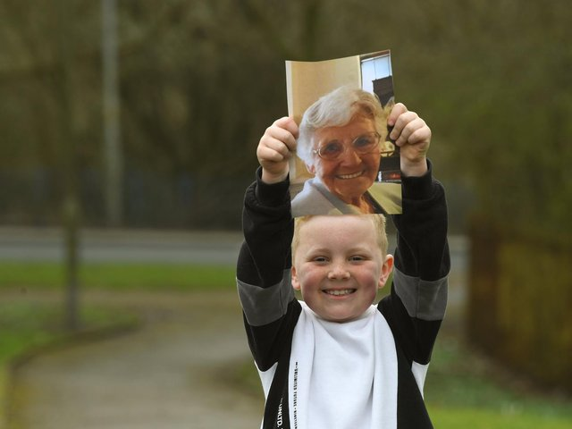 Ronnie Rea, 7, with a photo of his great-nana, Doreen who has inspired him to complete a Memory Walk. Photo: Neil Cross