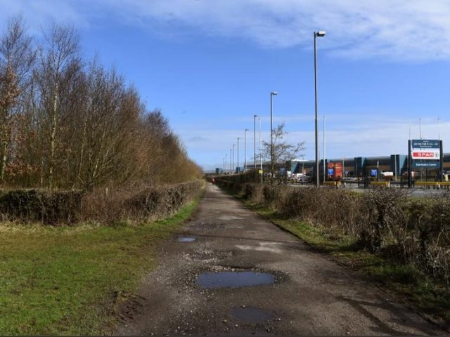 The site (left) is opposite the giant James Hall (Spar) distribution centre.