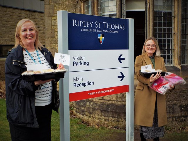 Bay Hospitals Charity manager Judith Read (left) is pictured receiving donations from Ripley St Thomas Church of England Academy's Sarah Taylor