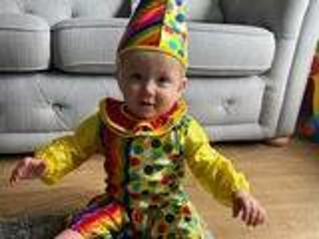 Rennon Jermy, 10 months, celebrated their first Comic Relief as a clown jester.