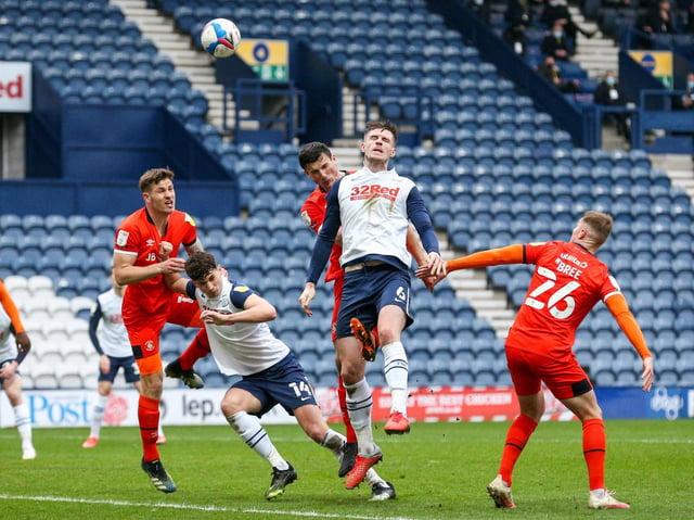 Preston North End defender Liam Lindsay flicks a header goalwards against Luton Town at Deepdale
