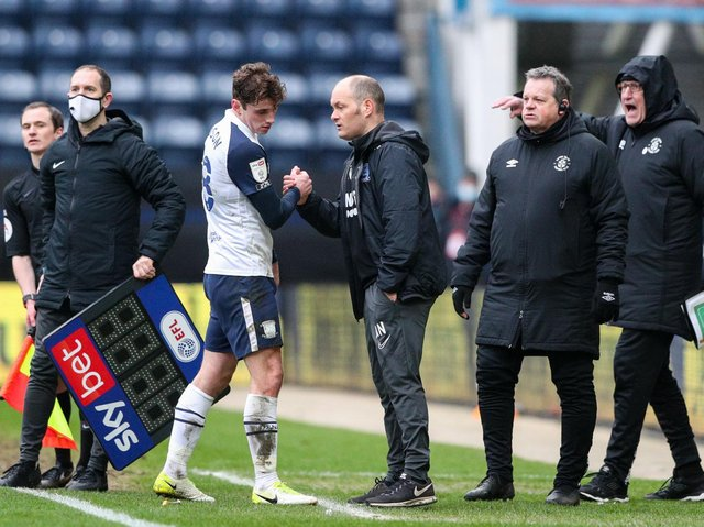 Ryan Ledson shakes the hand of boss Alex Neil after being substituted.