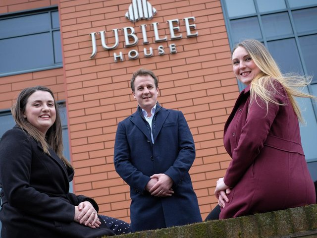 Craig Aikman with Sophie Mercer (left) and Yasmine Dragan (right) at Vincents Lytham office at Jubilee House
