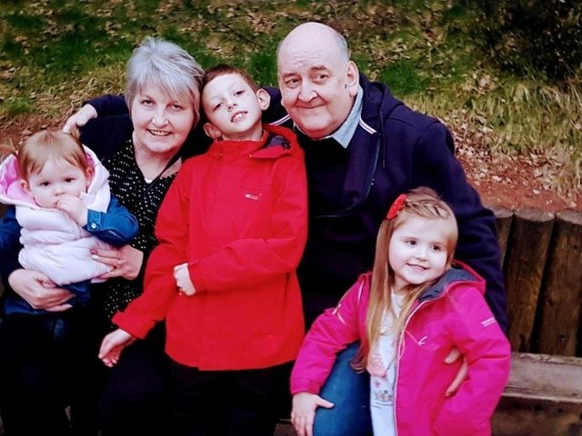 Keith Powell with his wife Denise and their grandchildren, Dillan, Mollie and Poppy