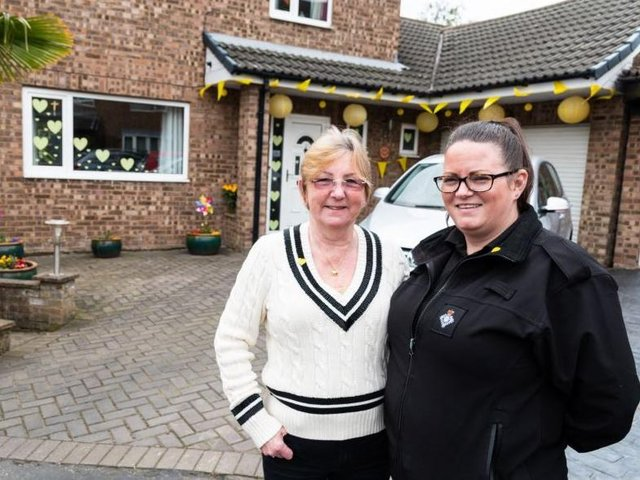 Rachael and mum Sue decorate house yellow on the Covid Day of Reflection