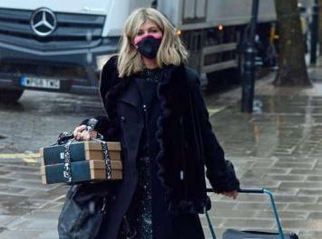 Kate Garraway carries gift boxes and pulls a suitcase as she arrives at Global Radio in London. Credit: PA Wire/PA Images. Picture by Ian West